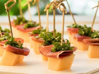 Melon & Prosciutto Skewers Over Greens Mix 1