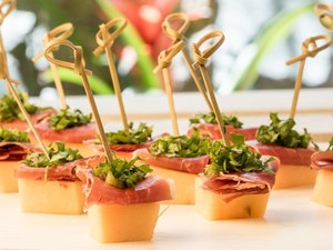 Melon & Prosciutto Skewers Over Greens Mix 2