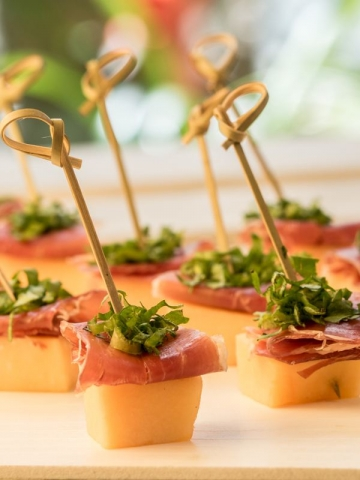 Melon & Prosciutto Skewers Over Greens Mix 3