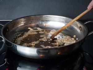 Cooking garlic in a pan.