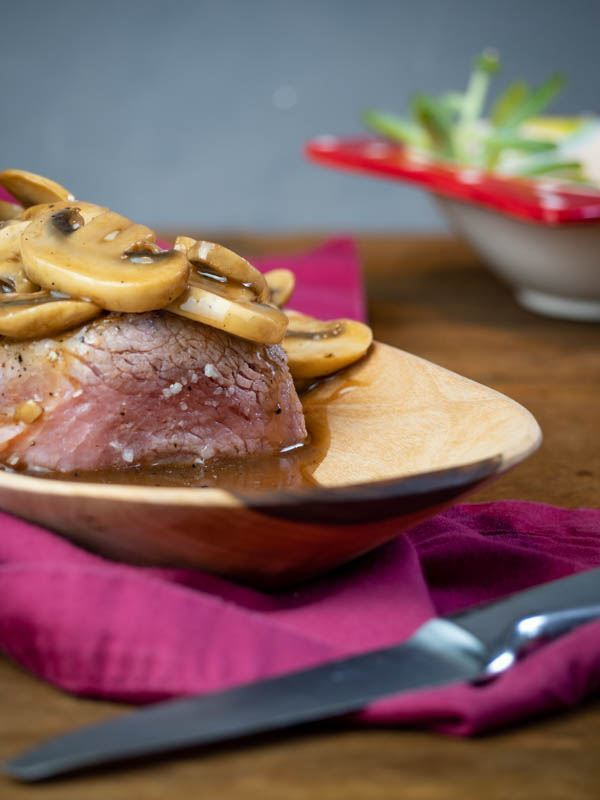 Beef Tenderloin with Bourbon & Mushroom Sauce recipe image. inthekitch.net
