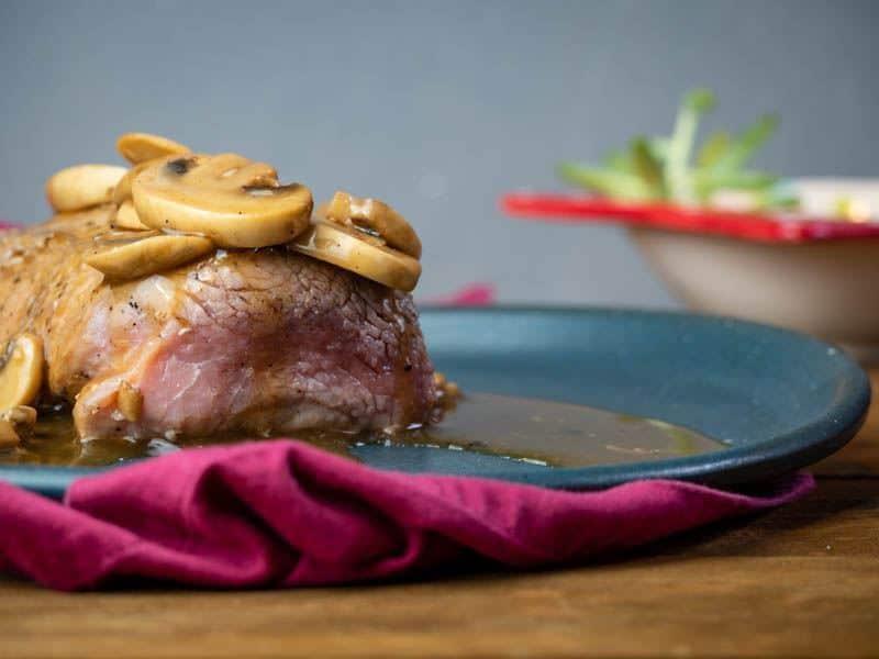 Beef Tenderloin with Bourbon & Mushroom Sauce in wooden bowl.