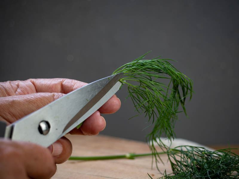 How to Chop Dill - Step 4 image. Cutting the dill. inthekitch.net