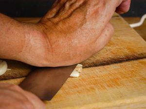 How to Chop Garlic - Step 3 image, smashing the garlic. inthekitch.net