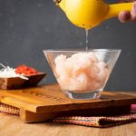 How to Make Ceviche - Step 4 image, adding lemon juice to bowl of raw fish. inthekitch.net