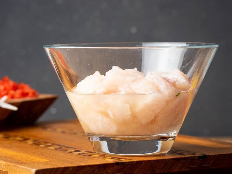 How to Make Ceviche - Step 5 image of raw fish in bowl. inthekitch.net