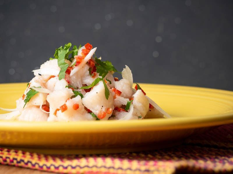 How to Make Ceviche - Step 9 image ceviche served on a yellow plate. inthekitch.net