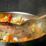 How to Braise Beef - Step 5 image, adding beef back to pan with veggies. inthekitch.net
