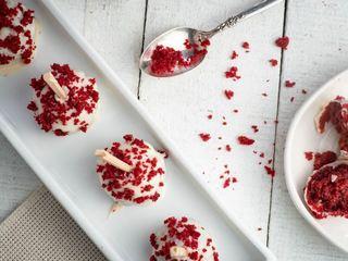 Red Velvet & White Chocolate Cake Pops in white rectangular serving dish. inthekitch.net