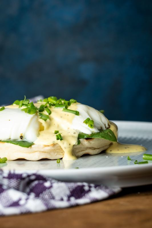 Eggs Benedict with Mock Bearnaise on plate.