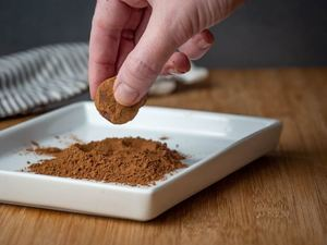 How to Make Chocolate Truffles - Step 8 image, rolling truffles in cocoa powder - inthekitch.net