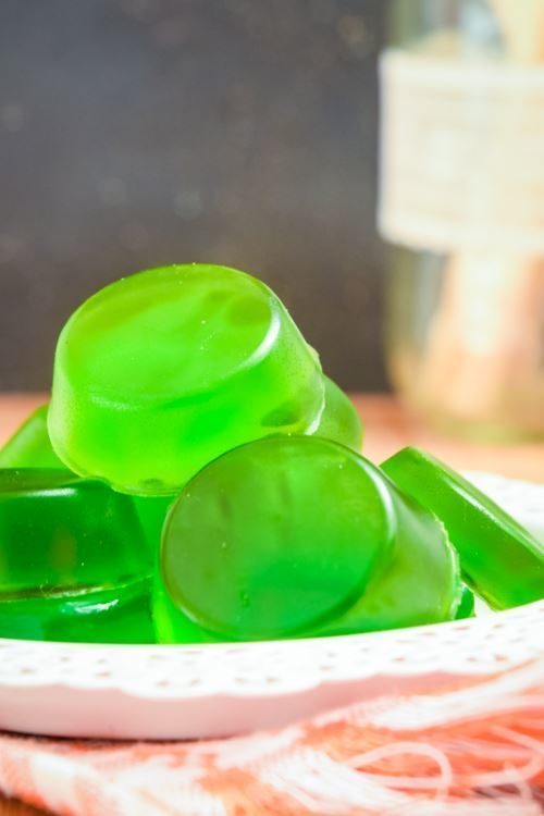 Green gummies on a plate.