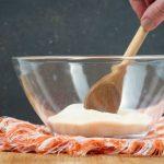 Stirring gelatin and sugar together in a bowl.