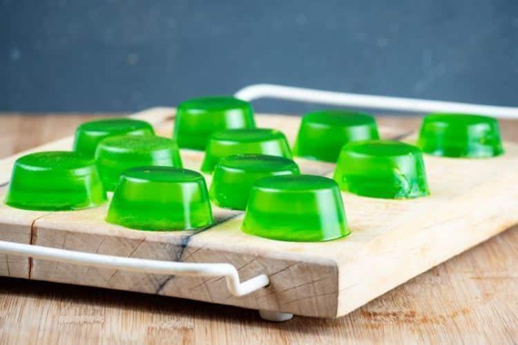 Gummies drying on a cutting board.