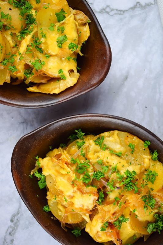 Electric Skillet Scalloped Potatoes in 2 wooden bowls.