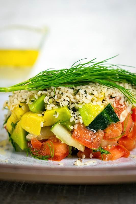Hemp seed salad on a plate close up with dill sprig.