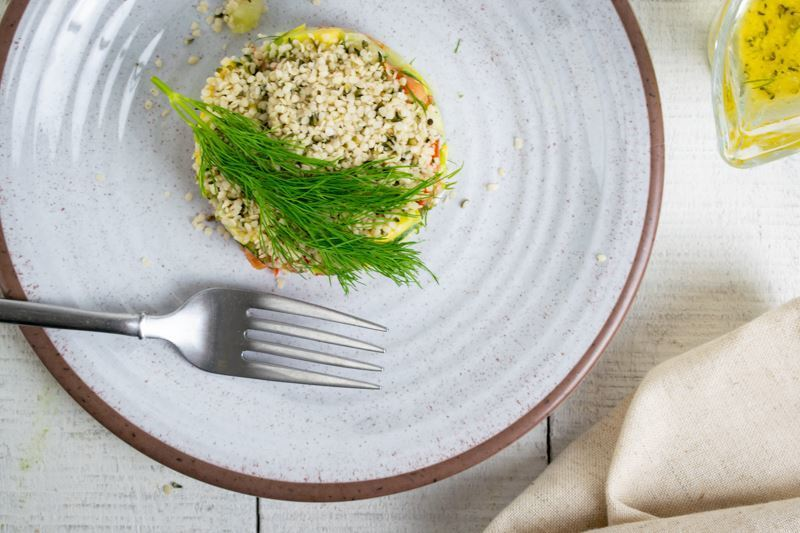 Hemp Seed Salad on plate close up with dill sprig.