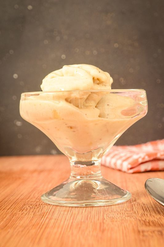Banana ice cream in a glass serving dish.