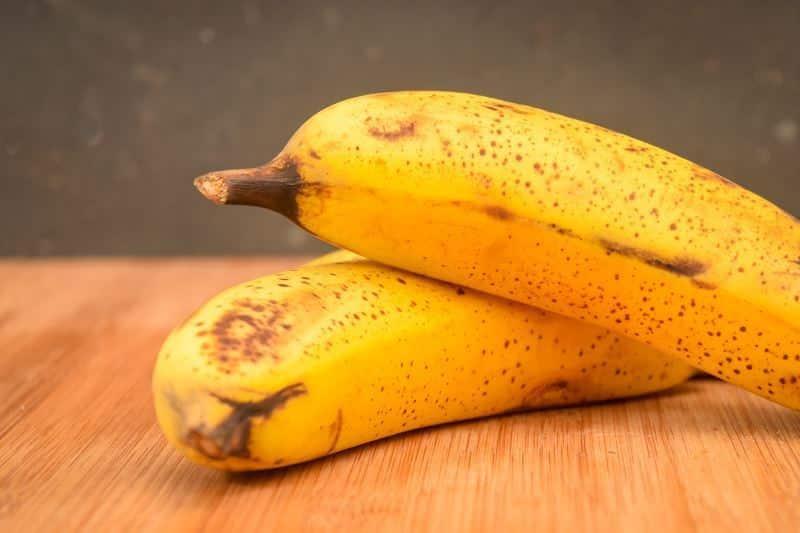 Bananas on a cutting board.