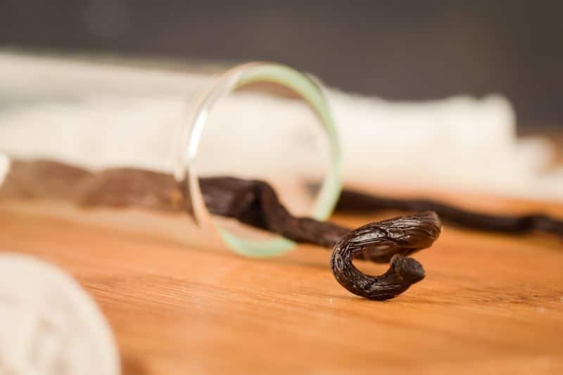 Vanilla bean pods in a glass tube.