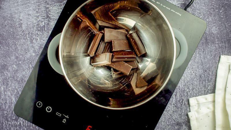 Bowl of chocolate bar chunks, melting.