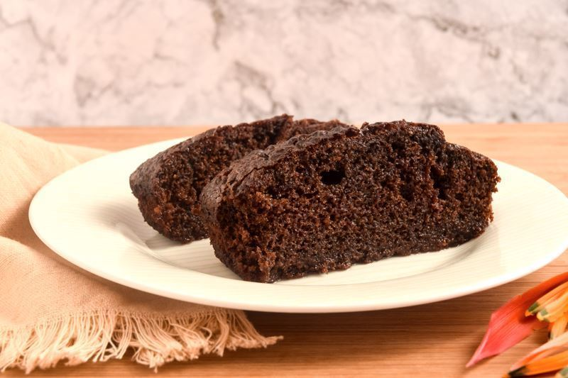 2 pieces of chocolate cake on a plate.