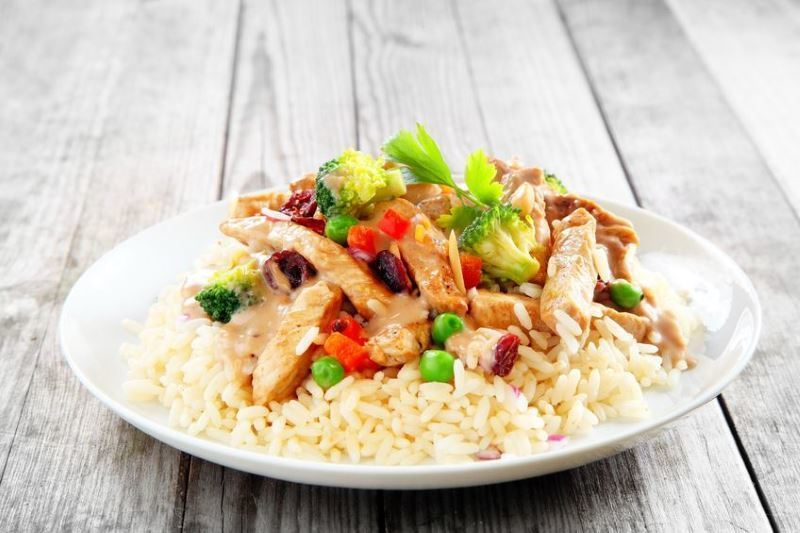 Quick & Easy Chicken Stir Fry E Skillet on a plate, wood background.
