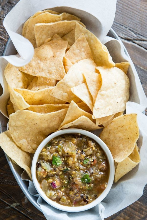 Chipotle Tomatillo Salsa with a pile of tortilla chips.