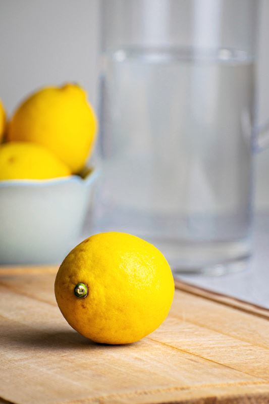 A pitcher of water and a lemon.