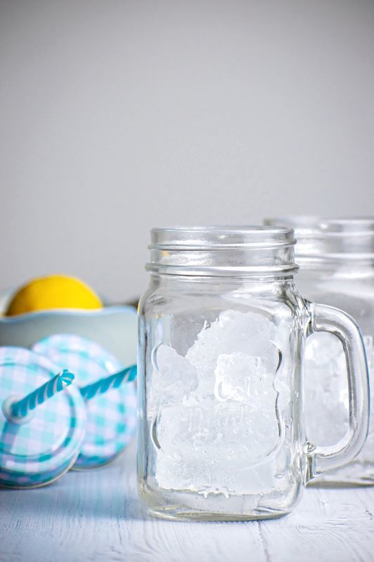 Decorative mason jars filled with ice.