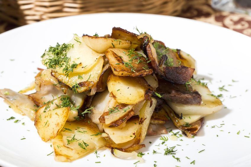 Potatoes and Onions in skillet.