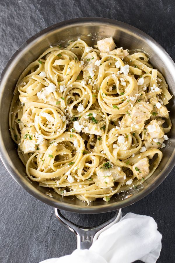 Tomatillo chicken pasta in a pan.