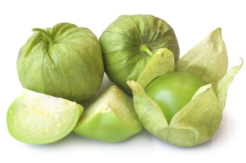 Fresh green tomatillos (Physalis philadelphica) with a husk on white background