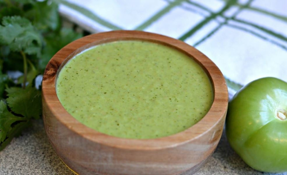 Authentic mexican salsa verde in a wooden serving bowl.