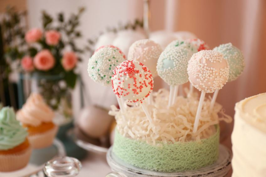 Cake pops in a loofah stand.