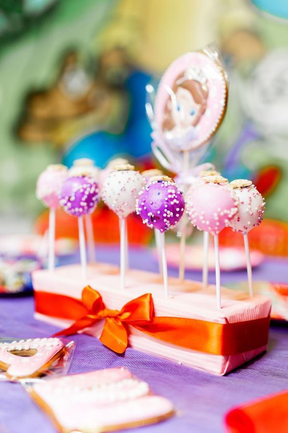 Present cake pop stand with a bow.