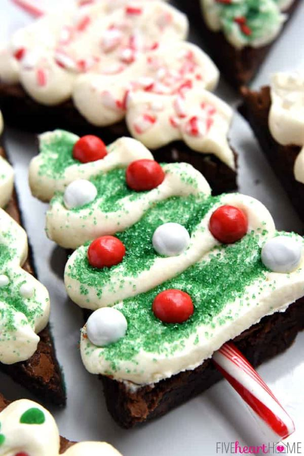 Christmas tree brownie pops on candy canes.