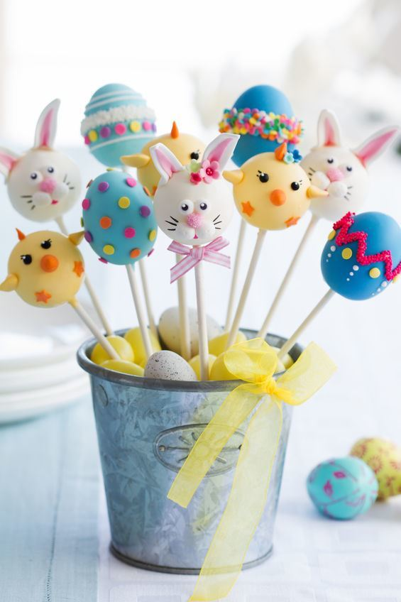 Cute easter cake pops in a small decorative pail.