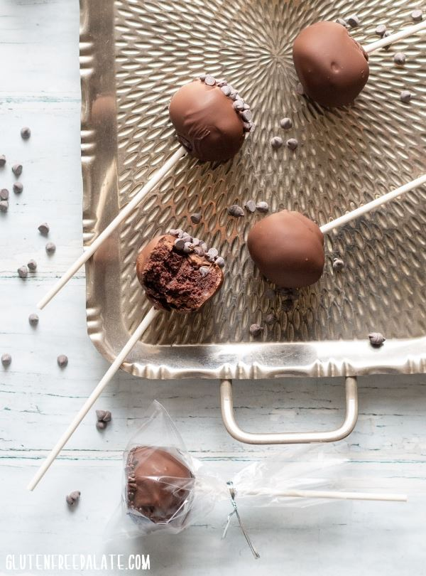 Chocolate gluten free cake pops laid out on a serving tray.