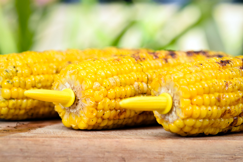 Close up of grilled corn cobs.