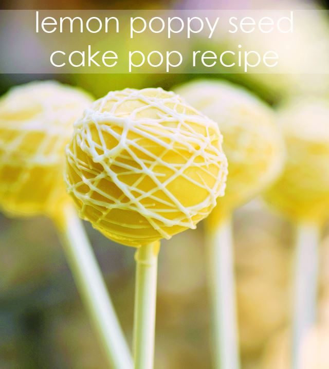 Lemon poppy seed cake pops in yellow frosting and white drizzles.