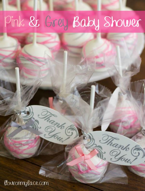 White girl baby shower cake pops with pink and silver icing drizzles and clear packaging plus thank you notes.