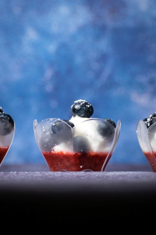 Red White & Blue Layered Fruit & Ice Cream treats in mini cups.