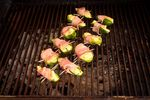 Jalapeno poppers on the BBQ charcoal grill.