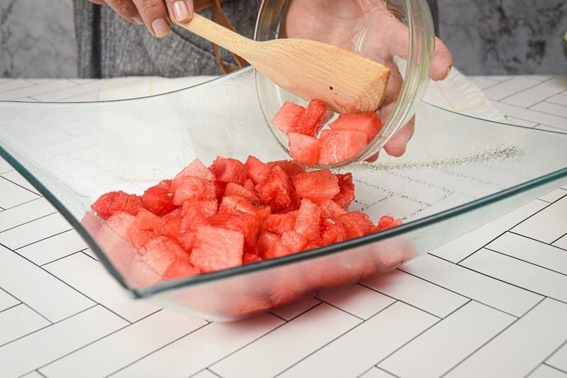 Chopped watermelon in a glass dish.