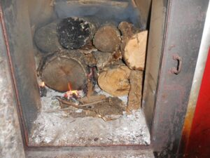 A wood fire started in a furnace.