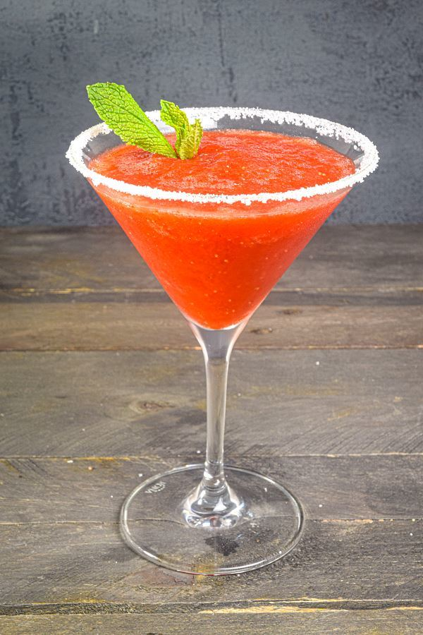 Frozen strawberry margarita with fresh mint leaves.