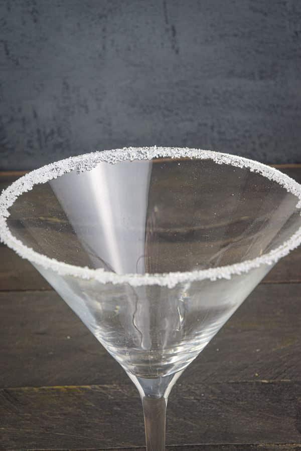 A martini glass rimmed with sugar.