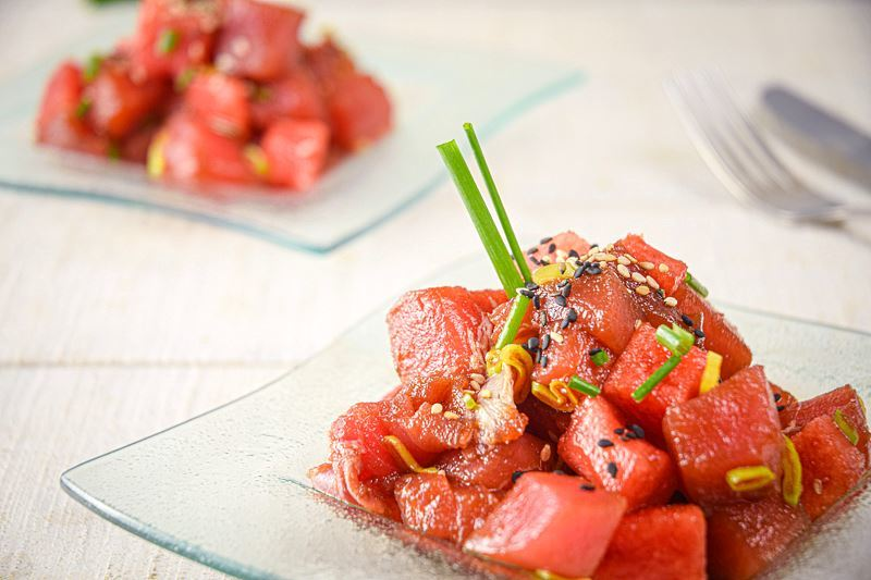 Tuna and Watermelon Tartare on a clear glass square plate.