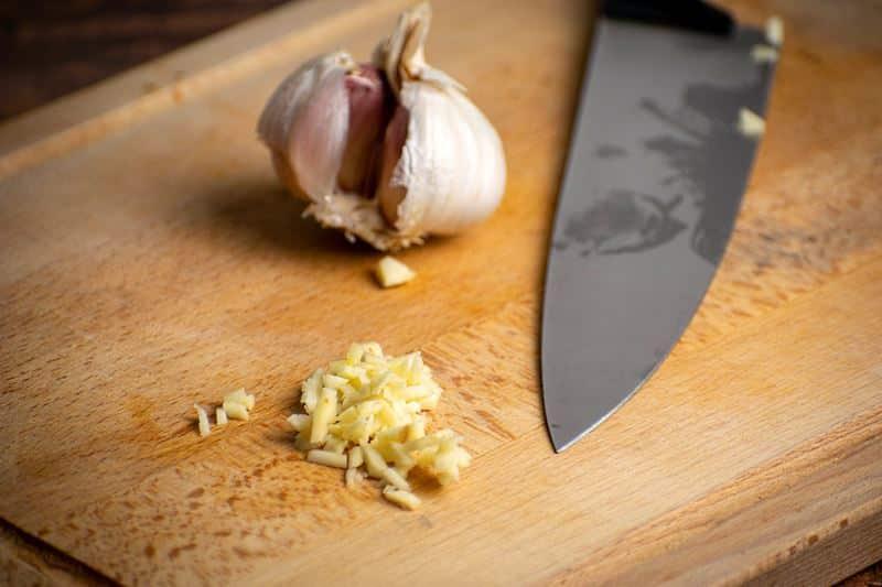 Garlic on a wooden cutting board.
